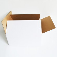 Practical cardboard box in medium size for storing, transporting or shipping various objects