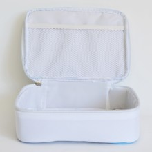 Stable storage box made of a neutral color fabric featuring a zipper.