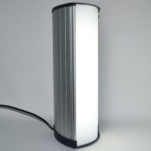 A small column of light - for use at the office or at home - with housing of brushed aluminum