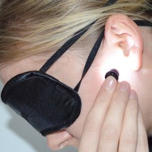 Light therapy on the ear canal with a small, lightweight device that gives you great flexibility and helps combat jet lag.