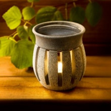 Aroma lamp made of soapstone in the shape of a lantern. It gives fragrance, warmth and light and is a unique one of a kind.