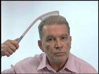 The comb allows you to reach the top or back of your head without putting undue stress on hand, arm or shoulder.